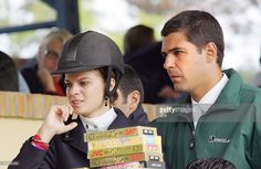 French-Greek Athina Onassis (L) looks at the events results beside her boyfriend Brazilian Alvaro Alfonso de Miranda Neto (C), known as Doda, 29 April, 2005 in Porto Alegre, southern Brazil. The couple take part in the equestrian XXXVII International Jump Championship, also known as The Best Jump. AFP PHOTO / JEFFERSON BERNARDES