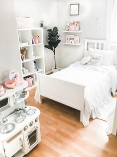 Here I'll be sharing all of the details of our 3-year-old and 4-year old girls' shared bedroom update. A room made up of neutral tones, soft pink accents, delicate details, and all white furniture for a bright and dreamy look! Vintage | Shabby Chic | Farmhouse | Rustic | All White | Little Girl's Room | Chic | Ikea Hack | Ikea Hemnes Nightstand | Hemnes Bed | Kallax | Toy Storage | Big Girl Bed | Home Decor | Home Design | Toddler Girls |