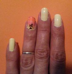 Yellow mani with beach sunset. Nails. Digits.