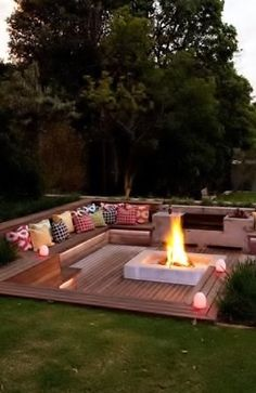 "Sunken fire pit with seating… Use this idea for bench along pool retaining wall for a ""couch"""