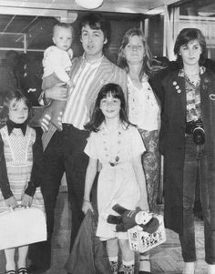 The mccartney's  1977.  Stella, James Jr in Paul's arms, Mary in front, Linda, and Heather.