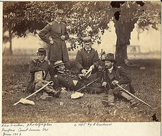 Group of officers at Headquarters, Army of the Potomac, Fairfax Courthouse. Studying the art of war.