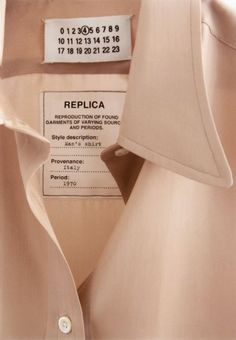 Every season since 1994, Maison Martin Margiela has introduced a capsule collection within its men's and women's lines called 'Replica'.  The 'Replica' pieces represent the Maison's interest in highly functional and meaningful garments and accessories. The character and charm of these pieces hand-picked throughout the world have been preserved. The 'Replicas' are faithfully reproduced and feature a special label inside each piece with the description, source and period of the original.