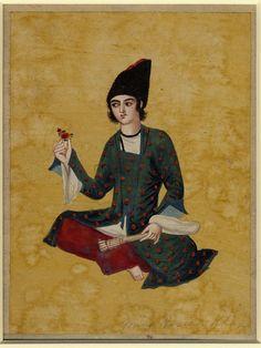 تصویری از یک شاهزاده جوان، قرن 19 میلادی، گواش روی کاغذ. portrait of a young prince seated cross-legged on the floor, holding a closed fan in one hand while gazing at a piece of red fruit held in the other. No text. Painted in gouache on paper, 19th, Iran.