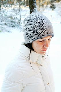 Samsara is a two layered reversible hat, featuring lovely lace panel on both layers.