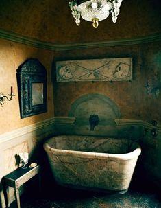An 18th-century Italian bath, Roman frieze and 1680 French mirror Axel V.in