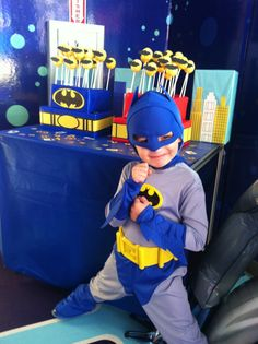 Batman in front of Gotham City Cake Pops table #batman #party #ideas #cake