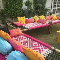 Seating space using bright charpais Indian Wedding Theme, Desi Wedding Decor, Indian Theme, Wedding Events, Wedding Ideas, Weddings, Mehendi Decor Ideas, Mehndi Decor, Indian Furniture