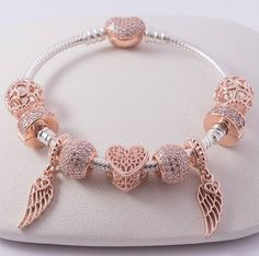 Pandora rose gold charm inspo