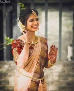 """Real Brides in Lightweight Bridal Outfits prove """"Less is More"""" - Jaykay Beauty - Real Brides in Lightweight Bridal Outfits prove """"Less is More"""" This South Indian bride in a simplistic saree, minimal jewellery, and her natural beauty = WOW ! South Indian Wedding Saree, Bridal Hairstyle Indian Wedding, Indian Bridal Sarees, Indian Bridal Hairstyles, Indian Bridal Makeup, Indian Bridal Outfits, Indian Bridal Fashion, South Indian Bride Hairstyle, Saree Wedding"""