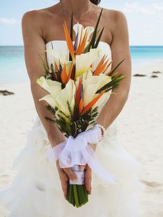 Tall Beach Wedding bouquet from a Mexico Destination Beach Wedding by Natalie Champa Jennings Photography