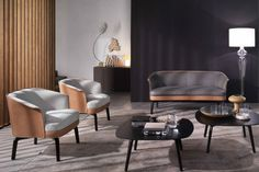 Sofá e poltronas Nivola, com estrutura de madeira sólida e revestidos de couro e tecido, design Roberto Lazzeroni para a Poltrona Frau