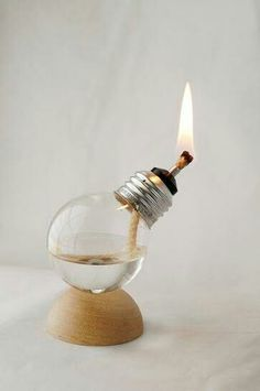 Turn an old burnt-out bulb as a whole other kind of light: a mini oil lamp