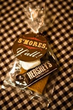 S'more kits for a wedding favor. This is a great idea. Does anyone not like s'mores?! PS Venues (like Bay Pointe Inn) will sometimes have a nice fire pit!