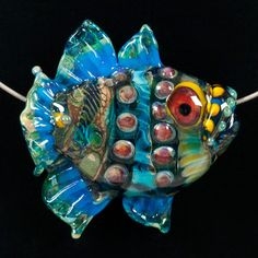 some day I will own one of her beads!        Glass Lampwork Bead Fish - Turquoise Green Stripped Tropical Fish. $137.00, via Etsy.