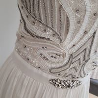 No automatic alt text available. Designer Wedding Dresses, Wedding Gowns, Wedding Day, Future Husband, Showroom, That Look, Bride, Unique, Pi Day Wedding