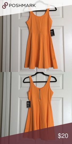 Express orange fit and flare dress Fit and flare orange dress from express. Never been worn with tags. Express Dresses