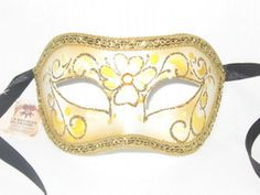 """Hand made and hand decorated Venetian """" Colombina TS """" mask from Venice, Italy.This is a Zorro style mask with a Yellow Floral design that is outlined in gold glitter. The mask also has a yellow jewel in the center of the mask in a flower. Venetian Masquerade Masks, Masquerade Ball, Halloween Carnival, Halloween Masks, Carnival Wedding, Yellow Painting, Pretty Little, Gold Glitter, Jewels"""