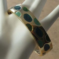 Stylish 1990s retro enamel green spots vintage bangle in its original box Pretty three different colors of green spots with a gold coloured spring opening