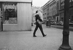 "A tired friend gets a lift in New York, 1965 - from photographer Joel Meyerowitz' retrospective monograph ""Taking my time"""