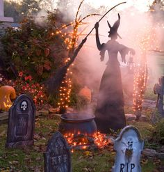 A jigsaw cutout of a witch strikes a frightening pose in this front yard. This is one time of year that a leaf-cluttered yard actually adds curb appeal.