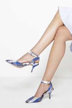 Pointed toe d'Orsay mid heel in a fun blue & grey plaid with adjustable ankle strap and buckle