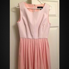 A light pink dress It is suede on top and the bottom is smooth and silky. It is very comfortable and great for any occasion. Nordstrom Dresses