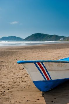 Boat Resting on Jaco beach in Costa Rica  by mylitleye