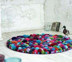 """Rugs often add another dimension of depth, warmth and design to a space. With the Pom-Pom or """"Bommel"""" rugs by MYK, they bring all of the above. Crafted from woolen pom-pom balls, there's an option of color and style when ordering. Diy Love, Pom Pom Rug, Tapis Design, Textile Design, Creation Deco, Cool Rugs, Home And Deco, Modern Interior Design, Diy Interior"""