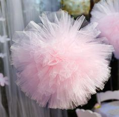 Pink tulle pompom? We made these for Bella's ballet themed birthday party, and now they are wonderful bedroom decor. Must repin onto our wedding board.