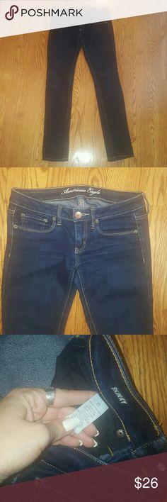 American Eagle dark wash stretch skinny jeans 6 Excellent condition! American Eagle dark wash stretch skinny jeans. Size 6 regular.  Bundle and save 20%! American Eagle Outfitters Jeans Skinny
