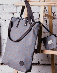 Imperial Easy Wool Bag. Soft wool finished with contrasting navy blue trim and natural leather straps transforms this bag into a glamour accessory.