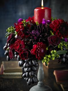 Black Grapes from California are stunning in this arrangement made up of dark red and purple flowers with green buds.