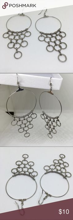 Circles Dangle Earrings Multiple circles dangle earrings in a silver toned color | Lightweight fashion jewelry | Fish hook back | Statement earrings | No brand | Questions welcomed Urban Outfitters Jewelry Earrings