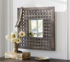 """Lattice Mirror #potterybarn,Overview  Our mirror's weathered latticework frame evokes the trellises found in country gardens.  •24"""" square, 1.5"""" deep •Fir wood frame with a whitewashed finish. •Mounting hardware included. •Catalog / Internet only."""