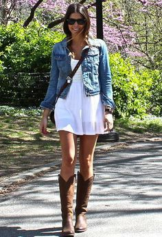 Jean jacket, white baby doll dress, and knee high dark brown cowboy boots