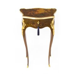 A superb late 19th century French ormolu mounted Vernis Martin decorated lift top side table of serpentine outline.