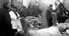 The photograph shows bodies in sacks piled three high on the deck of theCS Mackay Bennett, before being tipped overboard as the ship's priest conducts a service for a burial at sea. Rare image shows the final chapter of the doomed Belfast-built ship's story Henry Aldridge and Son.