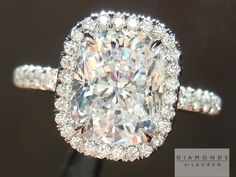 Cushion Cut colorless diamond platinum ring with micro pave halo. I love this ring and how is sparkles! The only thing I don't like is how the wedding band would not sit flush against the engagement ring.