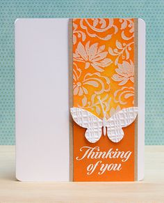 handmade card ... beautiful die cut and embossed butterfly ... bright orange and yellow panel with flower stencil over-lay ... beautiful!!