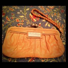 Fossil Fifty-four tan wallet/wristlet EUC Gorgeous leather wallet/wristlet with slots for credit cards and cash and some extra space inside for the bare essentials (lipstick, keys, etc). Perfect for those nights out when you need to look stylish and feel free without a big, bulky purse! Has a couple slight scuffs on the leather from the newspaper I used as stuffing (see pic 3), but you can't see it from the outside. Never used and otherwise pristine condition. Beautiful, vintage style…