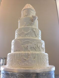 The bride was a Disney fan and wanted her cake all white with scenes from 5 different Disney movies, Little Mermaid, Cinderella, Aladdin, Beauty and the Beast and Rapunzel. Princess Wedding Cakes, Create A Cake, All White, Party Cakes, Rapunzel, The Little Mermaid, Beauty And The Beast, Cinderella, Bride