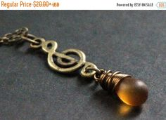 BACK to SCHOOL SALE Frosted Amber Teardrop Necklace. Music Necklace. Treble Clef Necklace. Musical Note Necklace in Bronze. Handmade Jewelle by TheTeardropShop from The Teardrop Shop. Find it now at http://ift.tt/2bjy2sN!