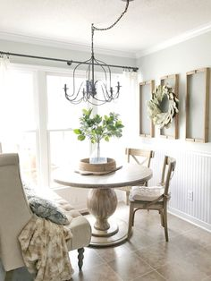 Vintage French Soul ~ Farmshouse Breakfast Nook with a French Flair- Magnolia Wreath and Greenery. Read More on Plum Pretty Decor and Design's Blog.