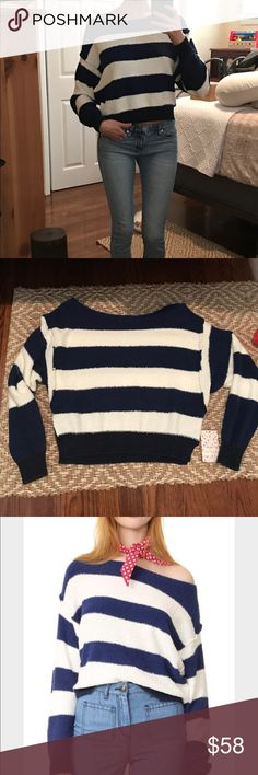 FP Candyland Striped Sweater I love his sweater but doubt I'll wear it much. Perfect slouchy fit. Perfect all year long. Size Small. Navy and NWT. No flaws to mention. Jeans also listed for sale in closet with excellent bundle discounts Free People Sweaters