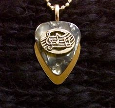 Silver Gold Musical metallic guitar pick pendent $26 Guitar Pick Jewelry, Guitar Picks, Metallic, Silver, Gold, Silver Hair, Yellow, Money