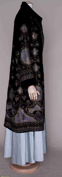 EMBROIDERED VELVET EVENING COAT, c.1925 Black silk velvet, blue silk appliques w/ metallic gold & silk floss tambour embroidery in Persian patterns, dull gold satin lining. Sideway