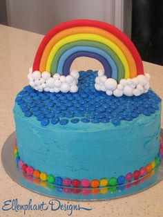 The actual cake! Team effort with my friend who made the fondant rainbow cake topper for me.