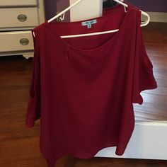 Red top Red stylish top only worn once and still looking new and clean. Other