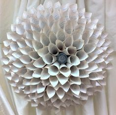Paper Wall Flower. I wonder about making a big one like this but stopping a few rows in from the edge and gluing another round of board into the middle for painting on or collaging - leaving outside petals as af frame. I think that would be neat.